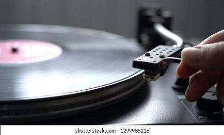Cinemagraph Loop Vintage Vinyl Turntable Record Player with female hand holding niddle