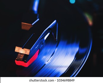 Cinemagraph, retro record vinyl player. Record on turntable. Top view close up. Loop-able Vintage photo of Old Gramophone, playing a music. Neon light