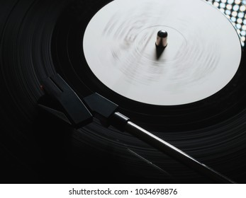 Cinemagraph, retro vinyl player. Recorder on turntable, viewed from above. Close-up. Pick-up lifts off.