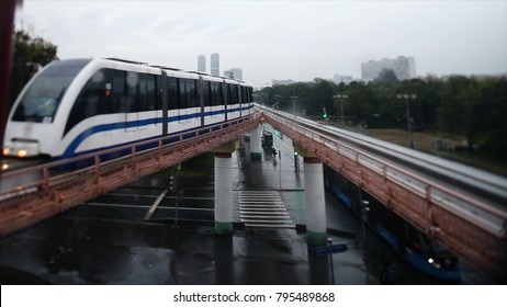 Cinemagraph - Train on elevated tracks within buildings at the Loop, Glass and Steel bridge between buildings. Train in the city