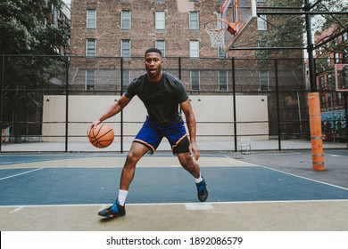 Cinematic image of a basketball player training on a court in New york city