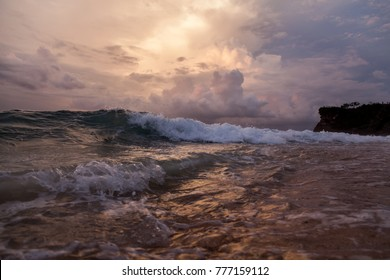 Cinematic landscape of the dramatic coastline. Beautiful image with tropical sea or ocean. Sunset on the beach. Sky background on sunset. Exotic nature concept.