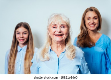 Cinematic portrait image of grandmother, mother and grandaughter. Concept about a three generations family