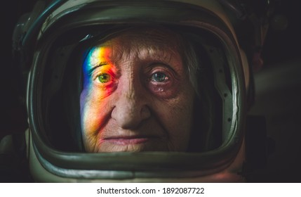 Cinematic portrait of an old astronaut coming back home. Grandmother with vintage space suit. Fiction concept about space exploration and science