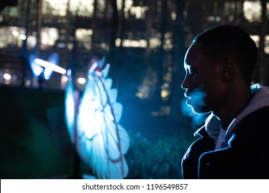 Cinematic portrait of young black man in cool lights