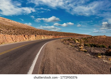 Cinematic road landscape. Humahuaca valley, Altiplano, Argentina. Misty road.