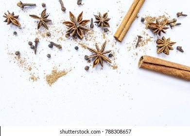 Cinnamon, cloves and star anise with isolated on white background. Top view or flat lay.