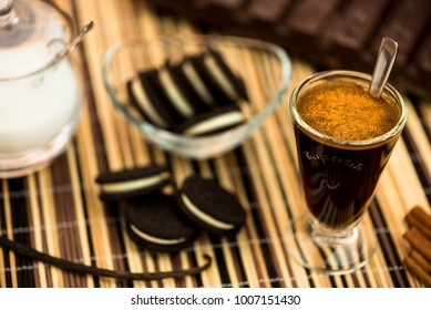 Cinnamon coffee with filled cookies