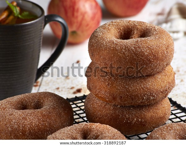 cinnamon donuts stacked with apple cider
