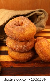 Cinnamon Donuts with wooden background