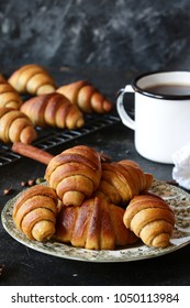 Cinnamon filling short crust pastry crescent rolls cookies. Cinnamon rugelach (croissant), freshly baked sweet buns or bread rolls. Copy space for your text. vertical