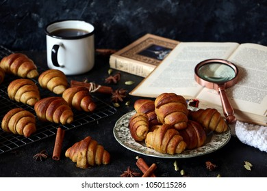 Cinnamon filling short crust pastry crescent rolls cookies. Cinnamon rugelach (croissant), freshly baked sweet buns or bread rolls. Copy space for your text, horizontal