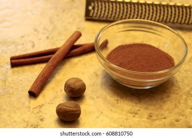 cinnamon, nutmeg and grater