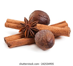 cinnamon, nutmeg and star anise isolated on white background