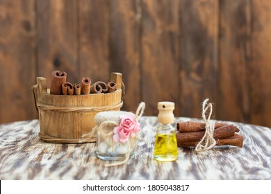 Cinnamon pods in wooden box on the table.