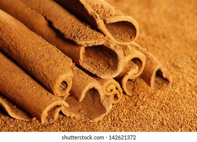 Cinnamon and Cinnamon Powder isolated on a white background in full frame.
