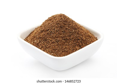 Cinnamon Powder in a square Bowl isolated on a white background in full frame.