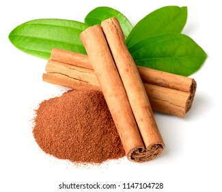 cinnamon powder and sticks with fresh leaves isolated on white