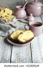 Cinnamon raisin bread for breakfast on white table with tea