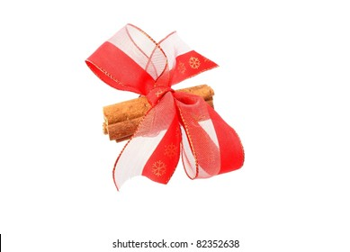 cinnamon with red ribbon - christmas decoration isolated on white background