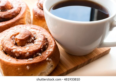 Cinnamon rolls with coffee. Selective focus.