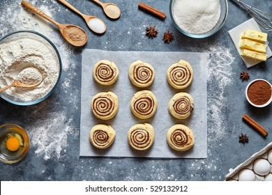 Cinnamon rolls dough preparation sweet traditional dessert buns pastry food baked homemade swirl Danish mini snack. Food ingridients flat lay on kitchen table. Top view