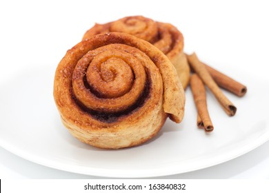 Cinnamon rolls on a plate, white background