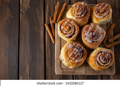 cinnamon rolls on wooden surface
