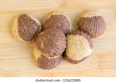 Cinnamon sandbakelse christmas cookies, two color, cocoa dark brown and vanilla light golden brown, delicious czech cuisine cookies, shells shapes on wooden background