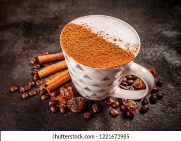 Cinnamon spiced coffee latte on dark vintage background