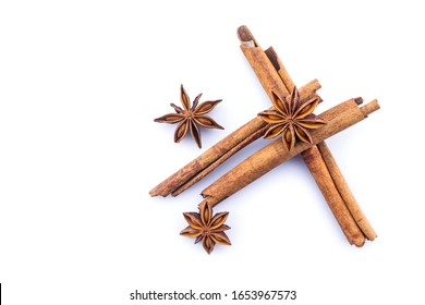 cinnamon and star anise on white background.