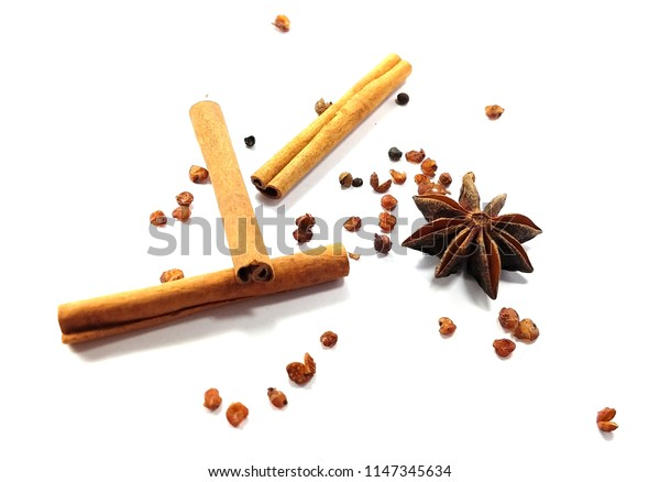 Cinnamon , Star anise , Pepper and other spices on white background