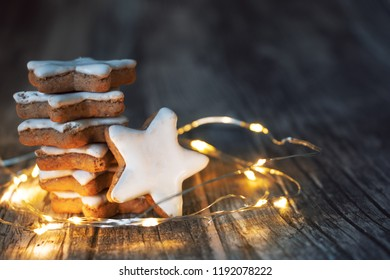 cinnamon star with LED light string on dark wooden background