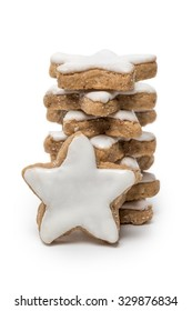 Cinnamon Stars christmas cookies with icing isolated on white background