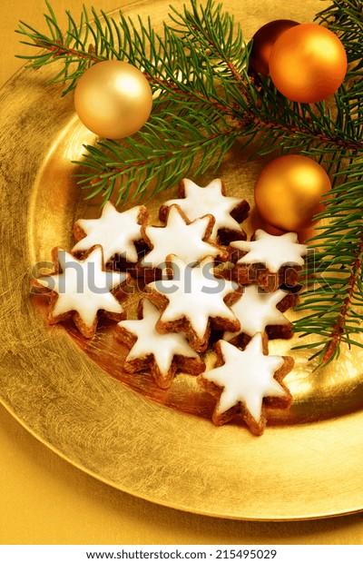cinnamon stars on golden plate