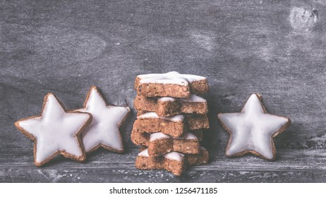 cinnamon stars on a wooden surface