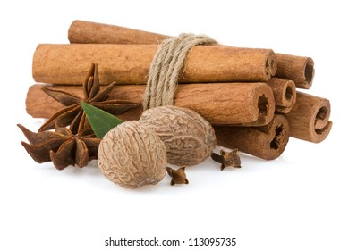 cinnamon sticks, anise star and nutmeg isolated on white background