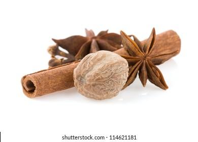 cinnamon sticks, anise star and nutmeg isolated on white background