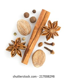 cinnamon sticks, anise star and nutmeg on white background