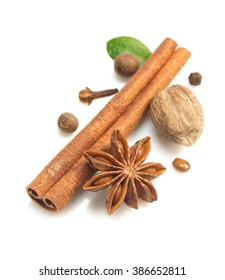 cinnamon sticks, anise star and other spices on white background
