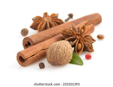 cinnamon sticks, anise star and spices on white background