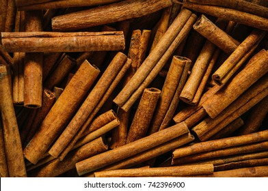 Cinnamon sticks background. Christmas drink. Traditional mulled wine with spices. Christmas, winter, new year concept. Flat, top view