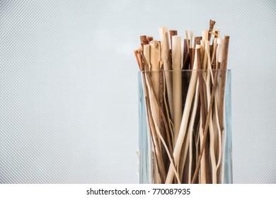 Cinnamon sticks in clear glass.