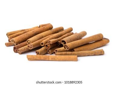 Cinnamon sticks close up isolated on white