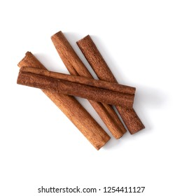 Cinnamon sticks isolated on white background closeup. Canella spice. Aromatic condiment background. Flat lay, top view.