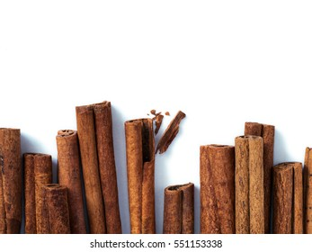 Cinnamon sticks isolated on white with copy space. Top view or flat lay