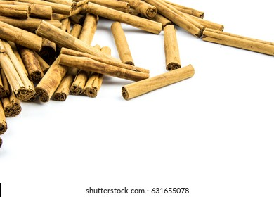 Cinnamon sticks isolated on white background cutout. Top view in focus. Wooden tasty bark spices. Seamless closeup texture material