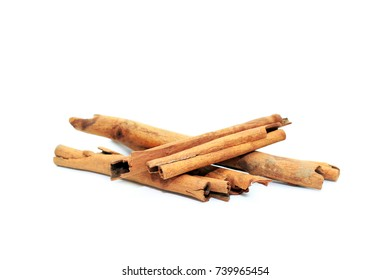 Cinnamon sticks isolated in white background.