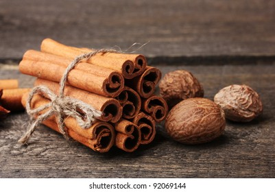 Cinnamon sticks and nutmeg on wooden table