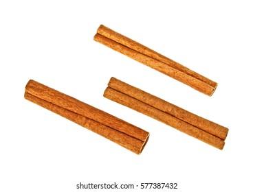 Cinnamon sticks on white background, top view